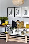 Striped sofa, glass table and yellow cushions and vases