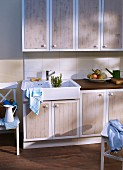 Kitchen cabinet doors refurbished with wood-effect panels