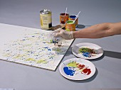 Instructions for making colourful kitchen splashback with splashes of paint