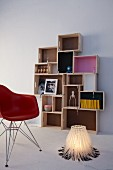 DIY shelving made from wooden crates of various sizes and lamp made from cable ties