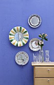 Decorative wall plates made from old china and round mirrored coasters