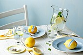 Table laid with lemons and lemon water