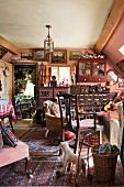 Living room crammed with collectors' items and antique furniture
