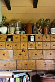 Old apothecary cabinet in country-house kitchen