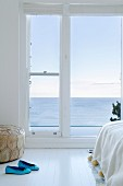 Bright bedroom with French doors and sea view