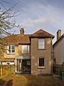 View from garden of 30s semi-detached house with contemporary conservatory extension