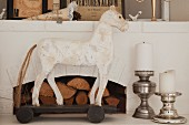 White horse ornament and pillar candles on silver candlesticks