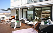 Lounge furniture and dining area on spacious roof terrace with teak floor