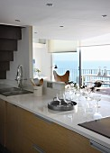 Kitchen counter below mezzanine level and balcony with sea view in background