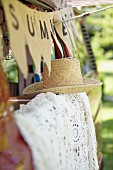 Summer atmosphere with garland, straw hat & lace blanket