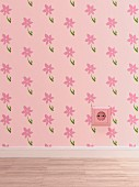 Pink electrical outlet on pink wallpaper with floral design