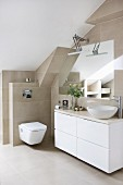 Modern washstand with countertop sink and white base unit in bathroom with sand-coloured wall and floor tiles