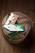 DIY gift boxes tied with ribbons on old wooden barrel