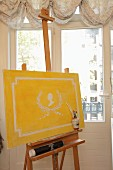 Hand-painted wallpaper motif on canvas on easel