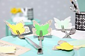 Yellow and green Easter arrangement of paper butterflies attached to forks
