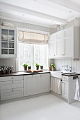 White, Scandinavian country-house kitchen with vintage ambiance