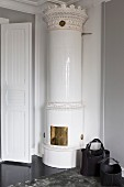 White antique corner fireplace in living room