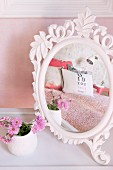 White vintage mirror with ornate frame on dressing table