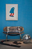 Upcycling - bench made from skateboards below modern picture of skateboard on blue wall
