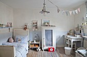 Pale blue walls and shabby-chic furniture in boy's bedroom