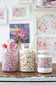 Screw-top jars decorated with floral patterns