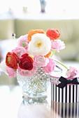 Crystal vase of ranunculus