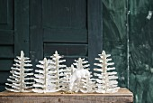 Hand-crafted woodland of paper fir trees made from pages of old books