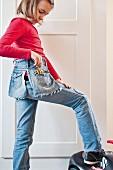 Girl with hand-made denim bag
