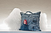 Hand-sewn, multifunctional denim cushion