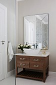 Washstand with countertop basin below mirror