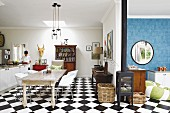Open-plan kitchen with eclectic dining area and chequered floor