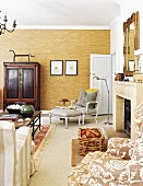 Baroque reading chair next to fireplace in classic living room in shades of brown