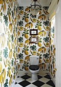 Wallpaper with botanical pattern and chequered floor in guest toilet