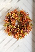 Wreath of autumn leaves on door