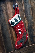 Christmas stocking hanging on wooden wall