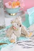 Old-fashioned teddy bear sitting on fabric