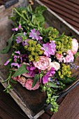 Bouquet of freshly picked, cottage-garden flowers (mallow, lady's mantle, catmint)