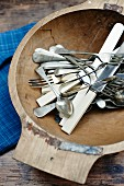 Wooden bowl of vintage cutlery