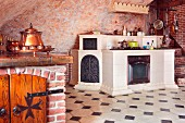 White-tiled, masonry kitchen counter and white-tiled floor with dark accent tiles in Medieval-style kitchen