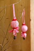 Christmas decorations made from polystyrene balls covered in ribbons, pompoms & pine cones