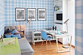 Bed, desk and classic chair in teenager's bedroom with blue and white tartan wallpaper
