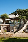 Stone stairs leading to Mediterranean stone house