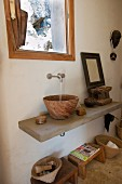 Wooden sink and wooden footstool under masonry washstand