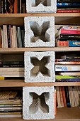Bookshelves hand-made from breeze blocks and boards