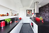Designer kitchen in black and white with Oriental accessories