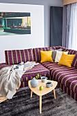Striped corner sofa and retro side table