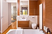 Designer-style, wood-clad ensuite bathroom