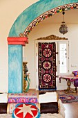 View of ethnic-style foyer through brightly painted archway