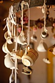 Crockery ornaments hung from suspended metal ring