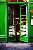 Green-painted front door of restaurant